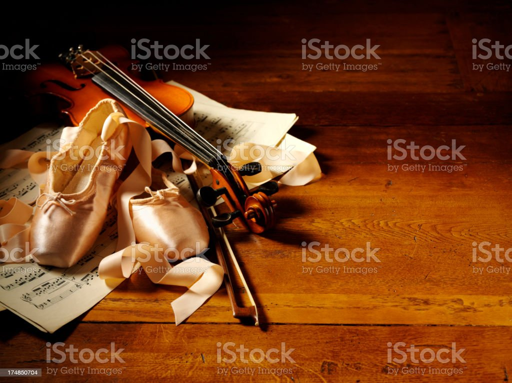 Violin with Pink Satin Ballet Shoes on Sheet Music royalty-free stock photo