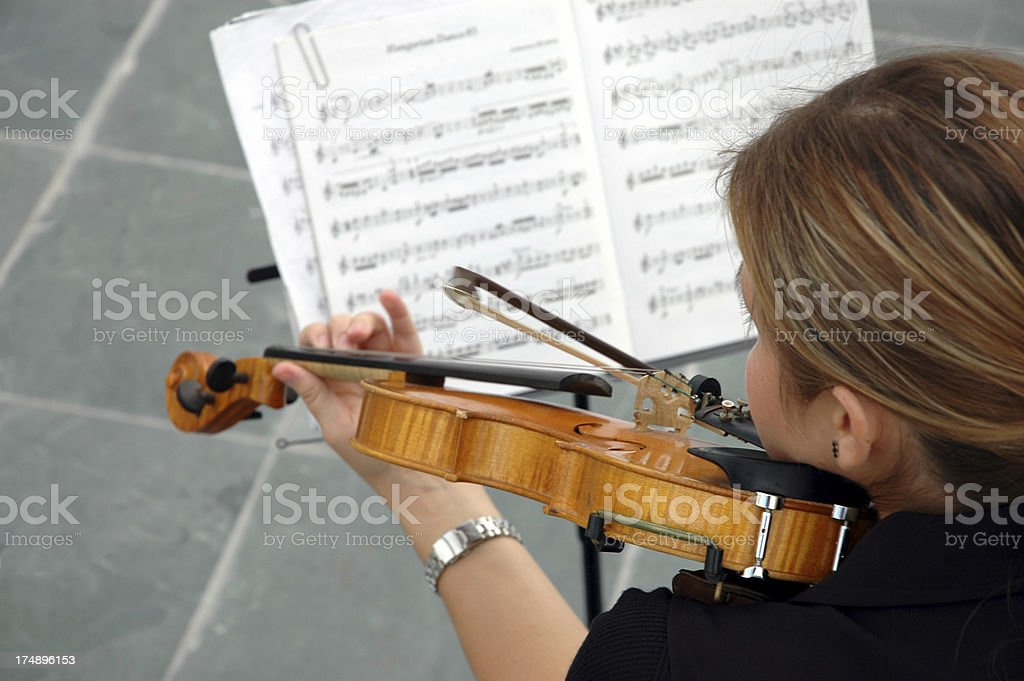 violinist girl and note in performance royalty-free stock photo