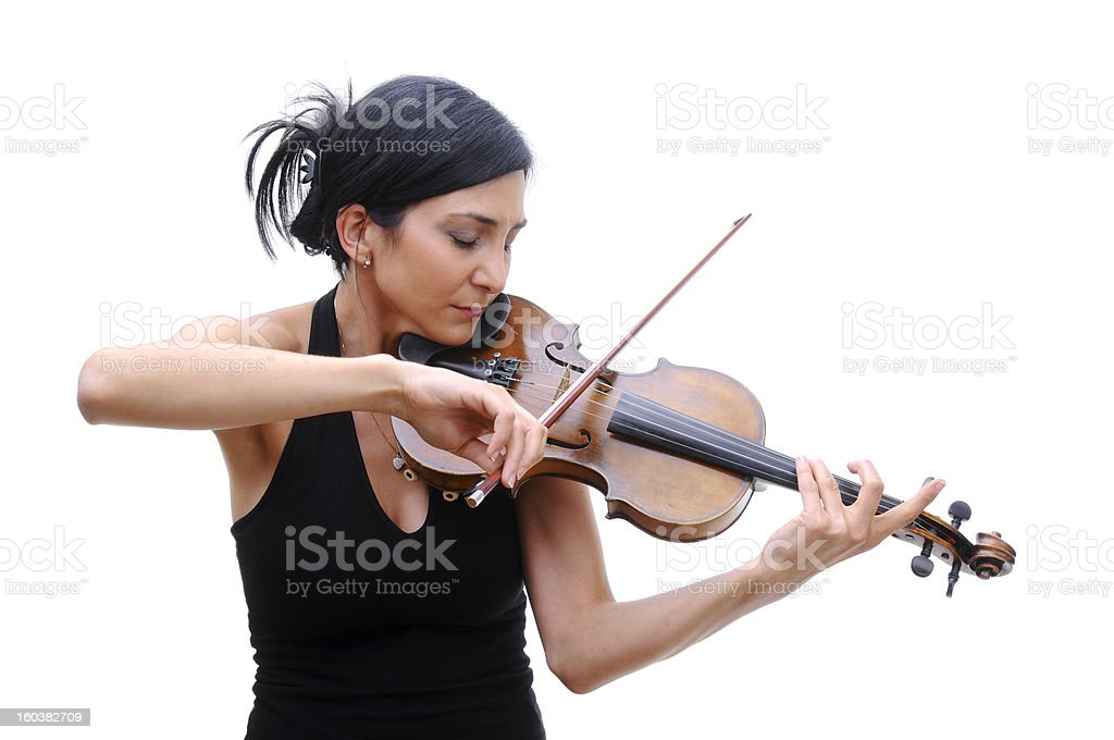 Violinist in black tee playing her violin with eyes closed stock photo