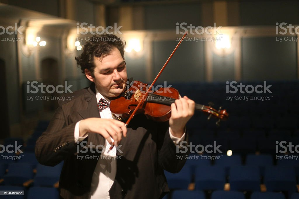 Violinist in concert stock photo