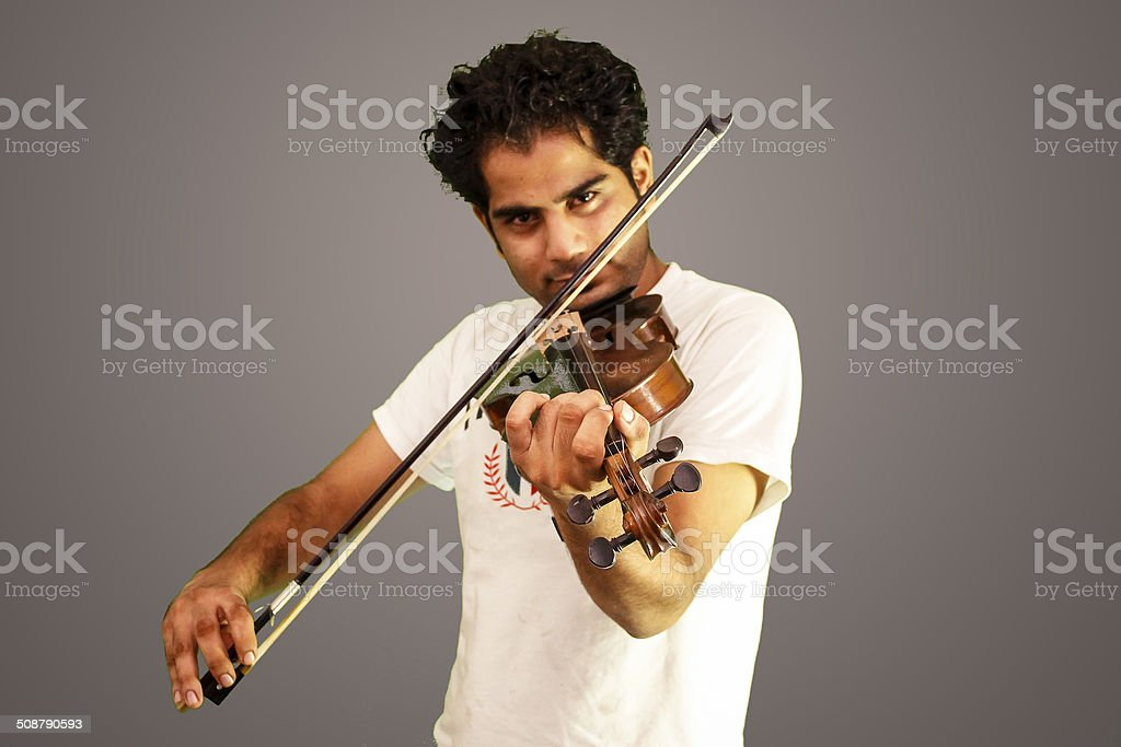 Violinist on isolated backdrop. stock photo