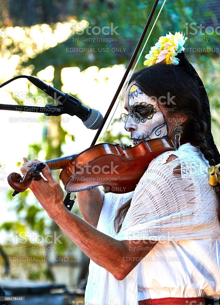 Violinist Performs Traditional Songs at Day of Dead Event stock photo