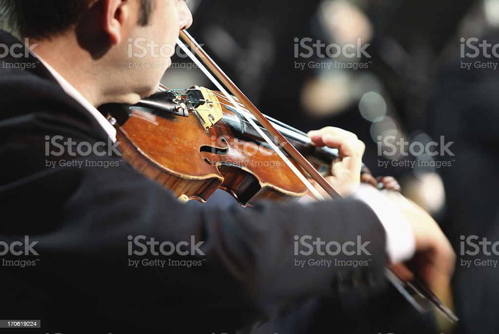 Violinist playing at the concert stock photo