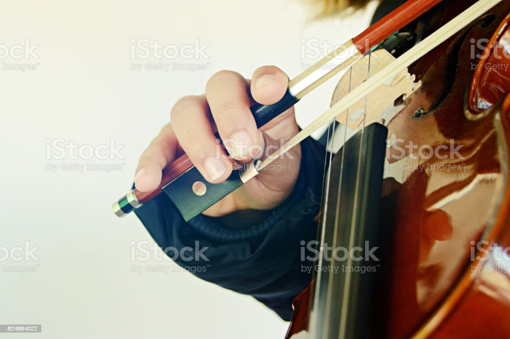 A violinist playing the stringed and bowed musical instrument, the violin stock photo