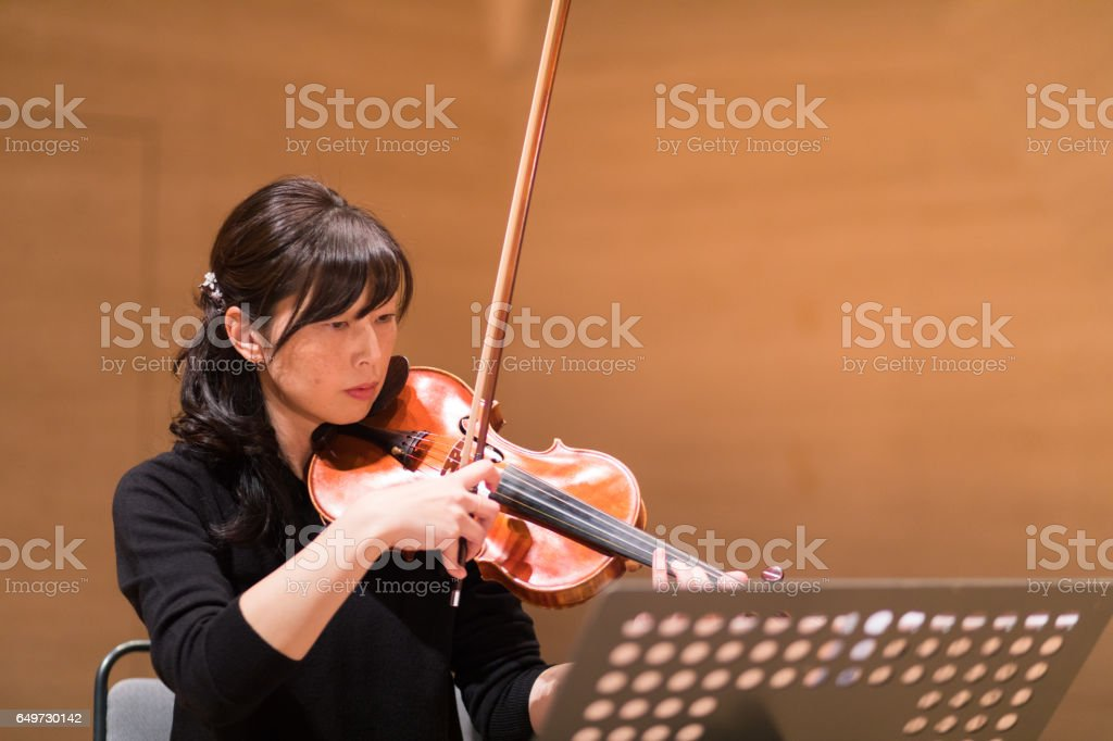 Violinist rehearsing before the concert stock photo
