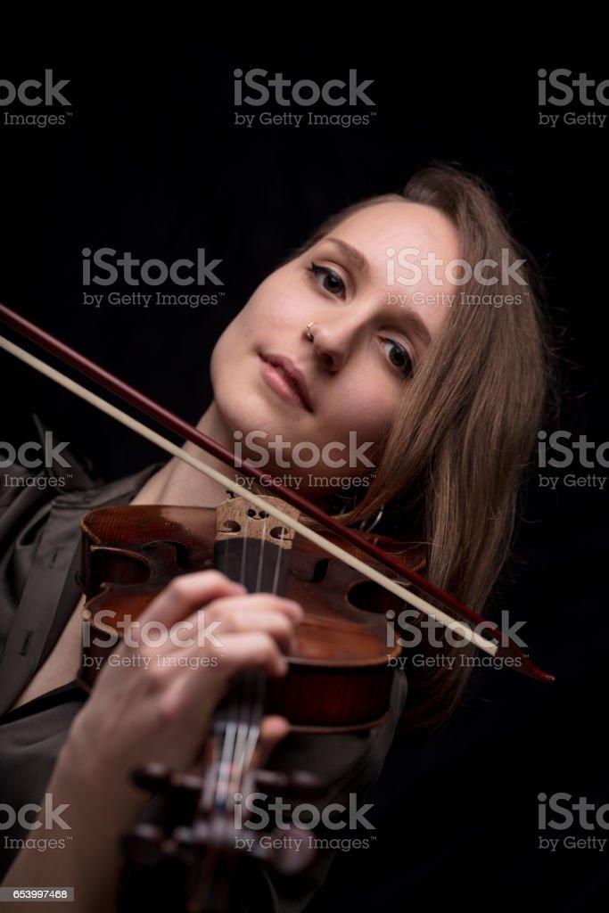 violinist woman looking at camera stock photo