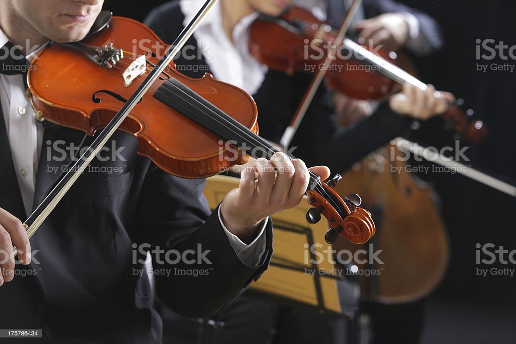 Violinists playing in concert playing classical music stock photo