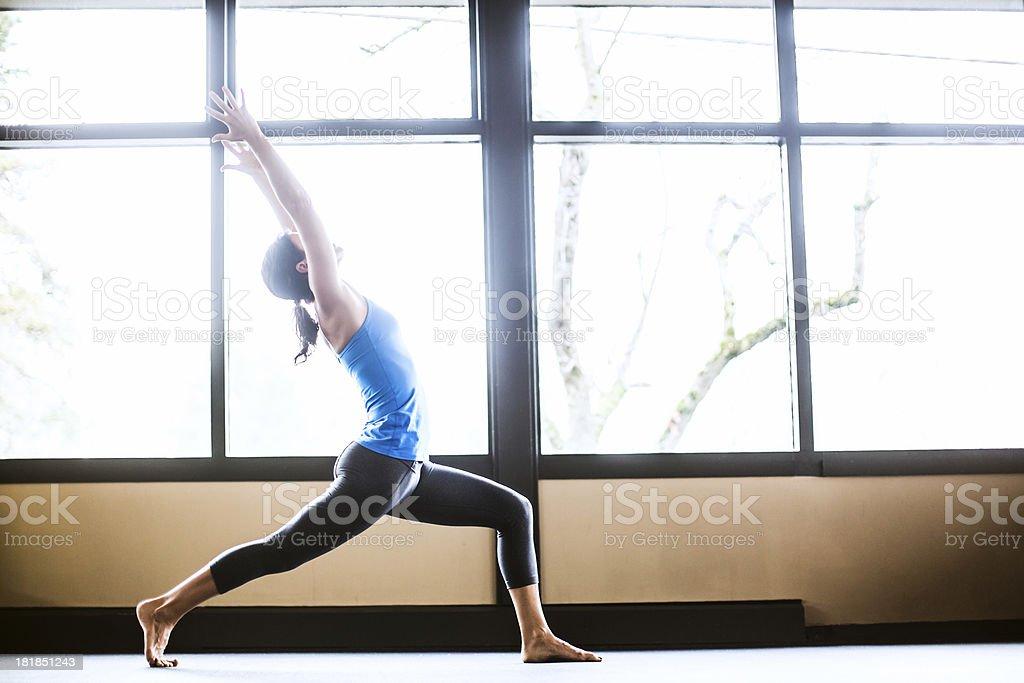 Virabhadrasana Pose in Yoga Studio stock photo