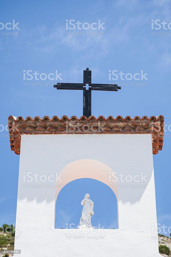 virgen y cruz stock photo
