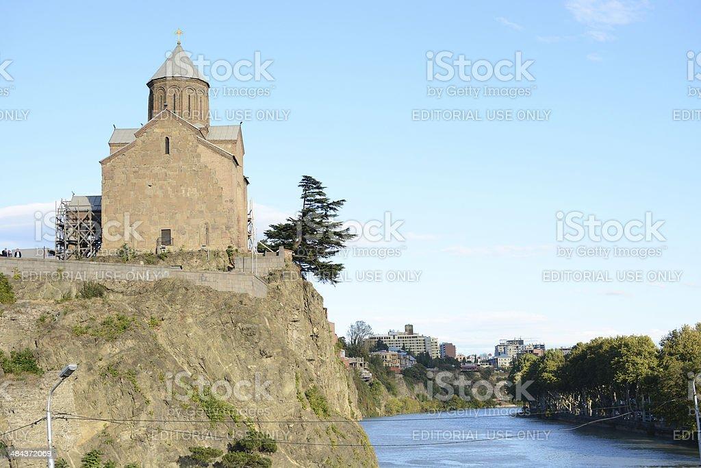 Virgin Mary Metekhi church under Kura river in Tbilisi stock photo
