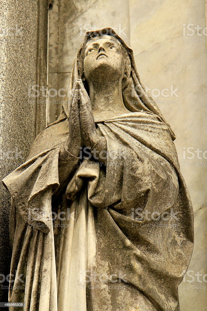 Virgin Mary praying to skies, Recoleta cemetery, Buenos Aires stock photo