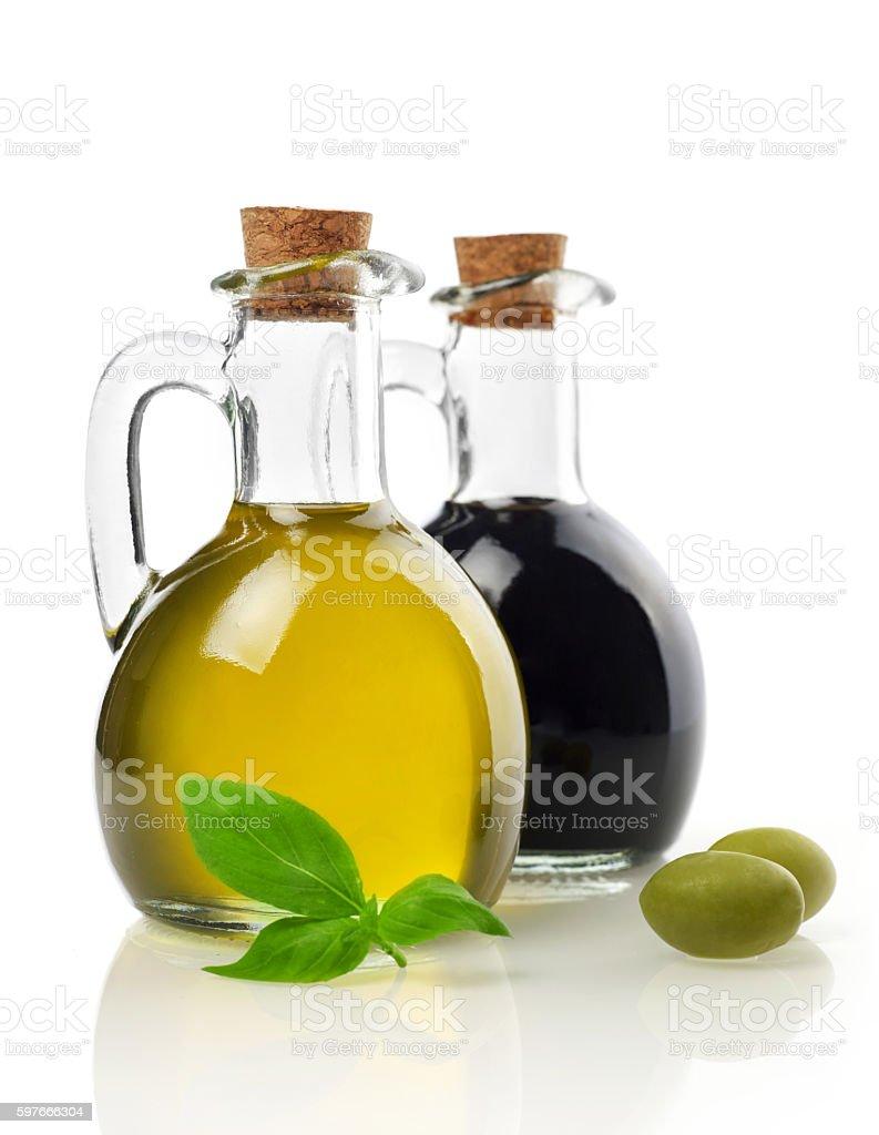 Virgin oil, vinegar, olives and basil stock photo