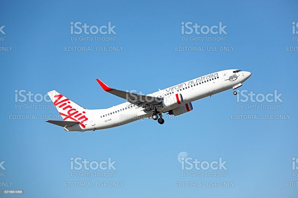 Virgin Over The Moon: plane taking-off with moonrise. stock photo
