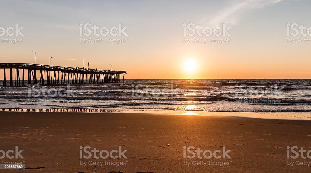 Virginia Beach Boardwalk Fishing Pier with Sun at the Horizon. stock photo