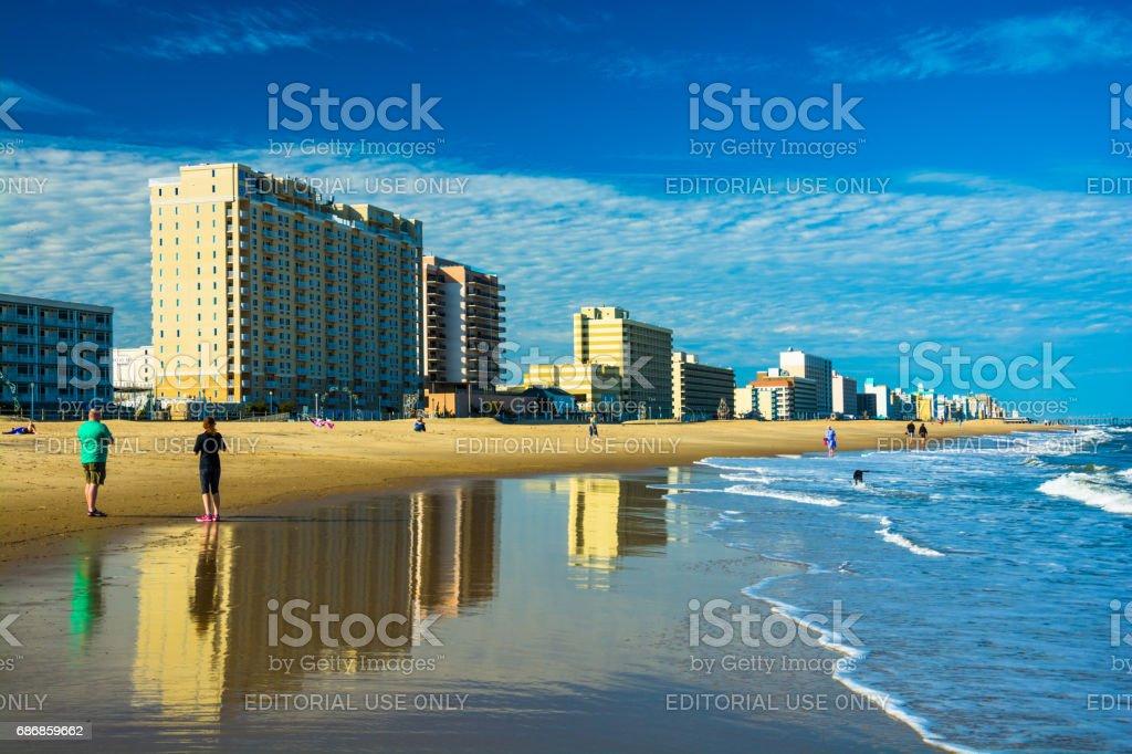 Virginia Beach Coastal Skyline with Beach, Skyline Reflections and People stock photo
