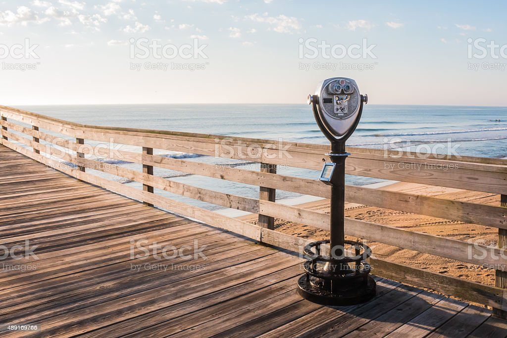 Virginia Beach Fishing Pier with Sightseeing binoculars stock photo