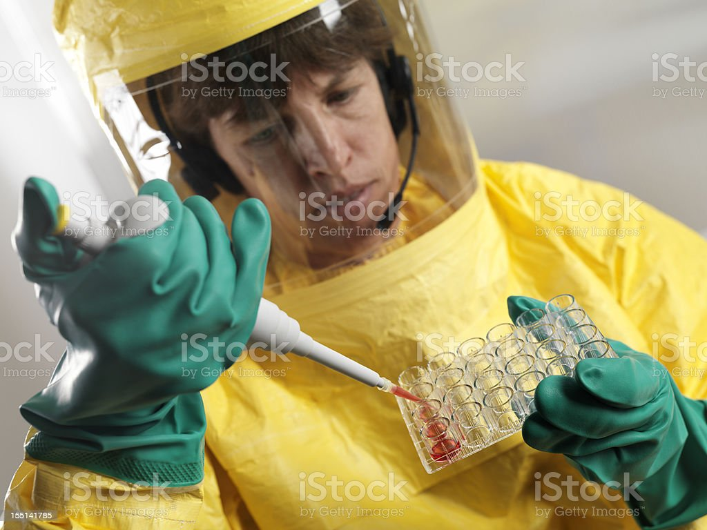 Virologist working with blood serum in high security laboratory stock photo