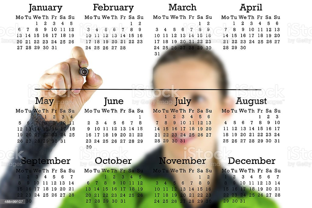 Virtual calendar with a woman writing in copyspace stock photo