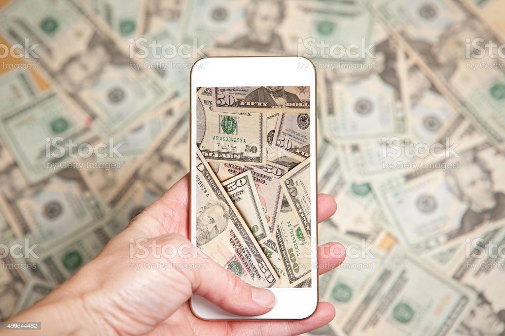 Virtual Cash On A Smart Phone Screen stock photo