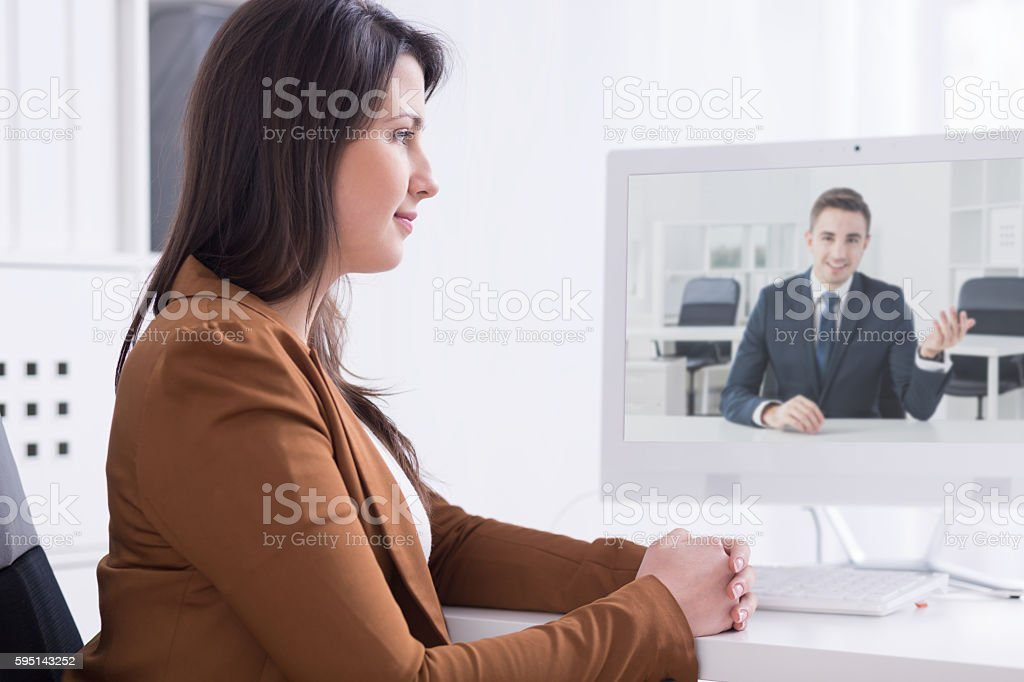 Virtual colleagues during morning brief stock photo