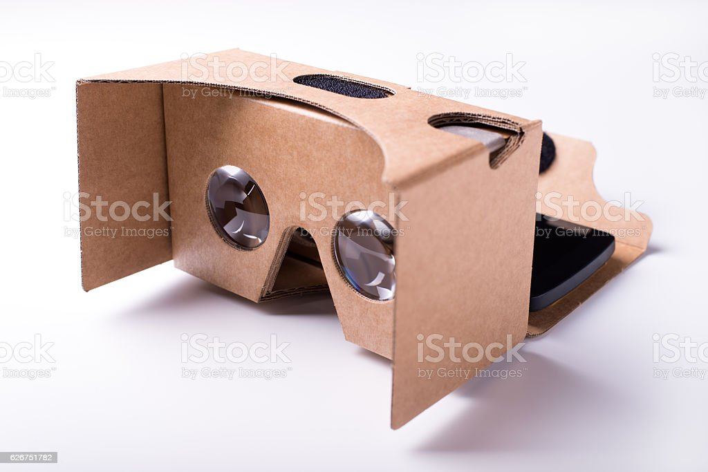 virtual reality cardboard headset with a smartphone, over white stock photo