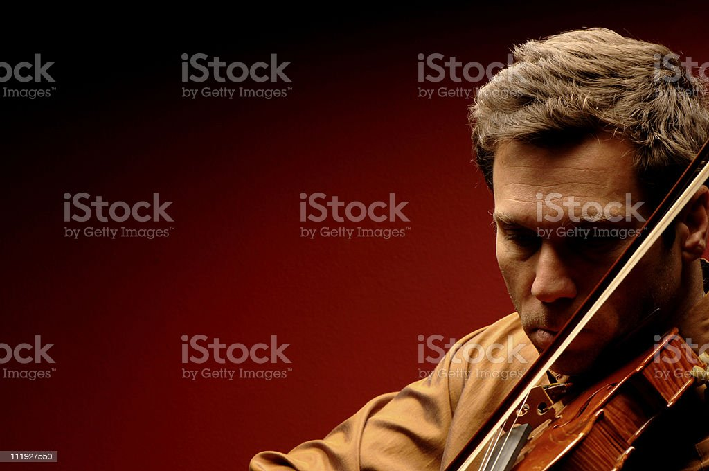 Virtuoso Male Violinist on Red Background royalty-free stock photo