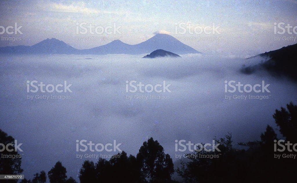 Virunga Mountains Volcanoes valley fog layer Rwanda Central Africa stock photo