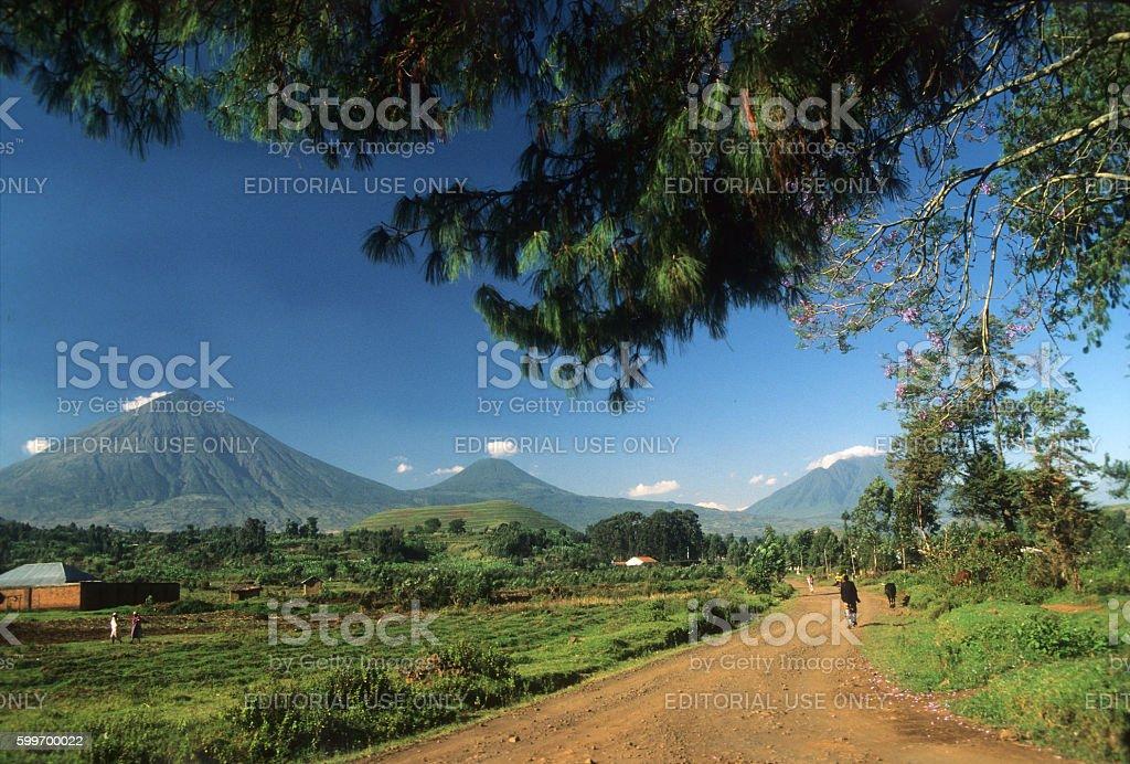 Virungas volcanoes in background viewed from Kisoro town, Uganda stock photo