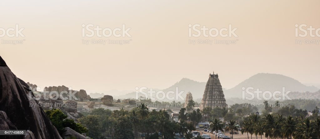 Virupaksha temple tower and temple city on a hazy evening. stock photo