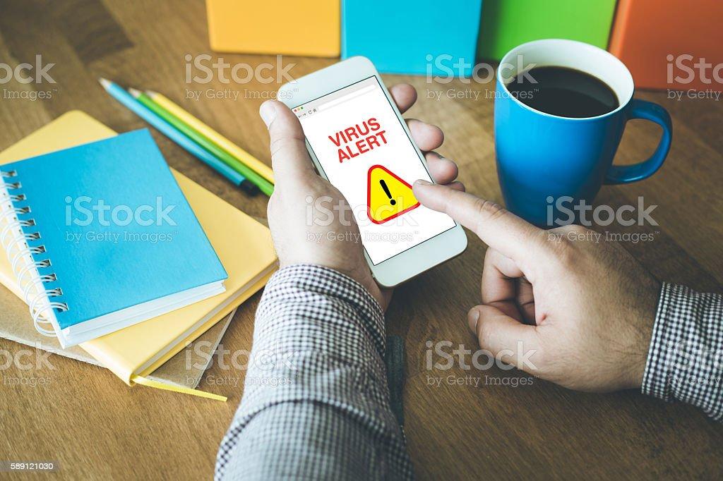 Virus Alert Sign on smartphone stock photo