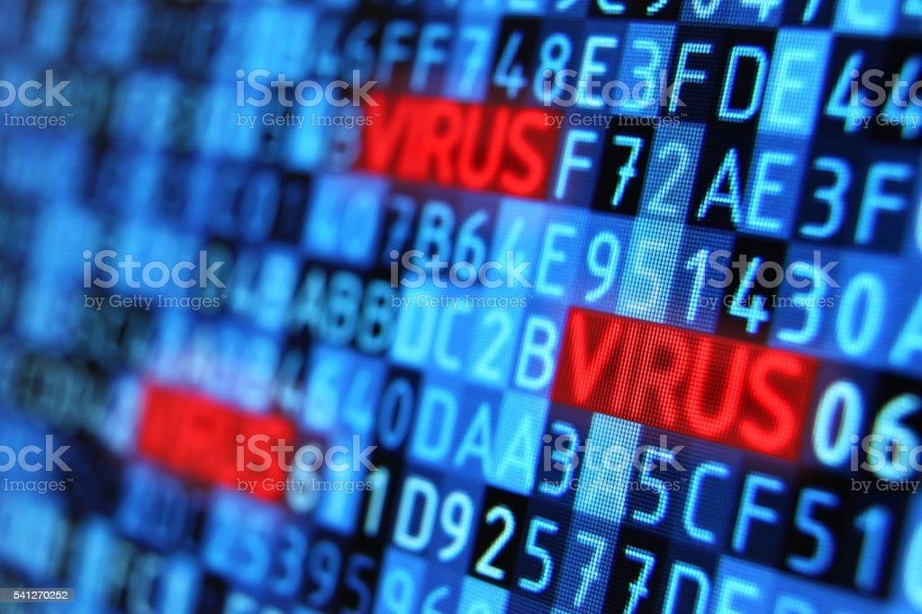 Virus hiding into programming code on computer monitor stock photo