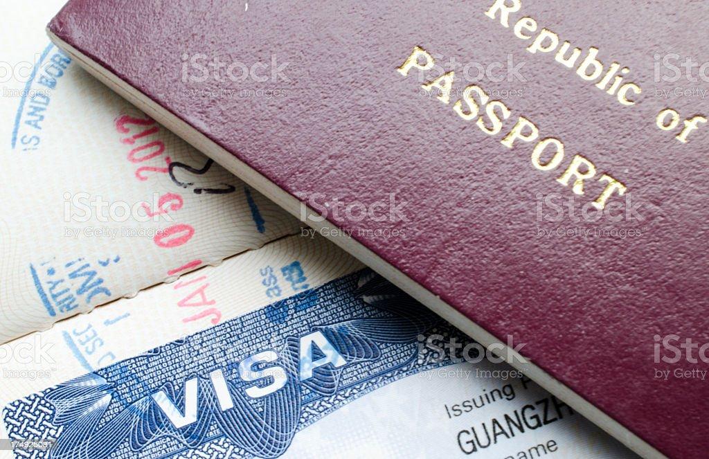 USA visa and Chinese passport stock photo