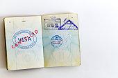 Visa cancelled stamp in passport