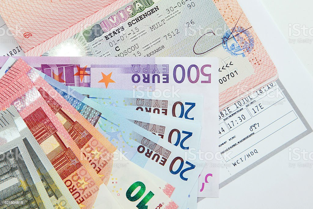 Visa in the passport, Euro banknotes and boarding pass stock photo