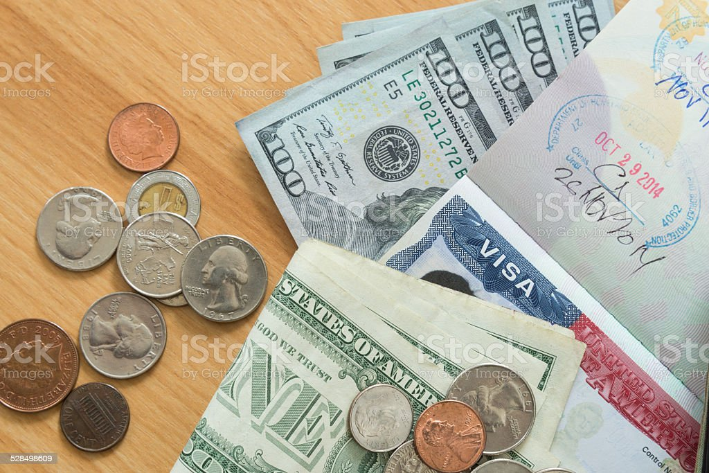 US Visa passport dollar bills coins stock photo