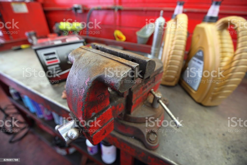 Vise clamp in garage and car repair shop stock photo