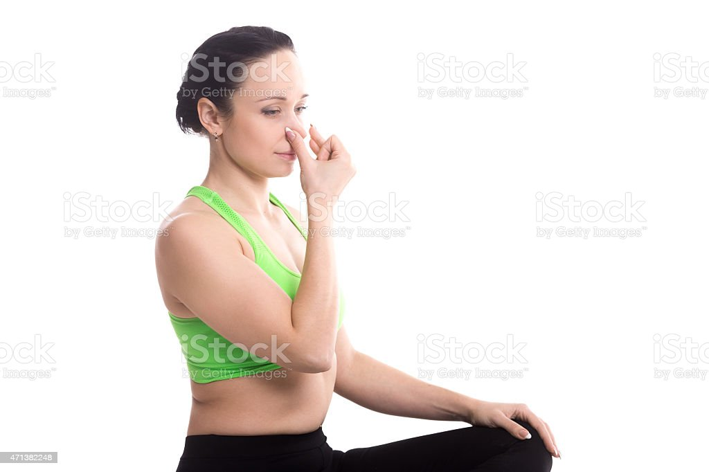 Vishnu Mudra in hatha yoga Alternate Nostril Breathing stock photo