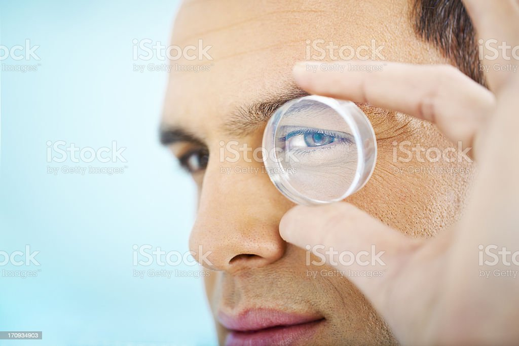 Vision: man looking through a lens royalty-free stock photo