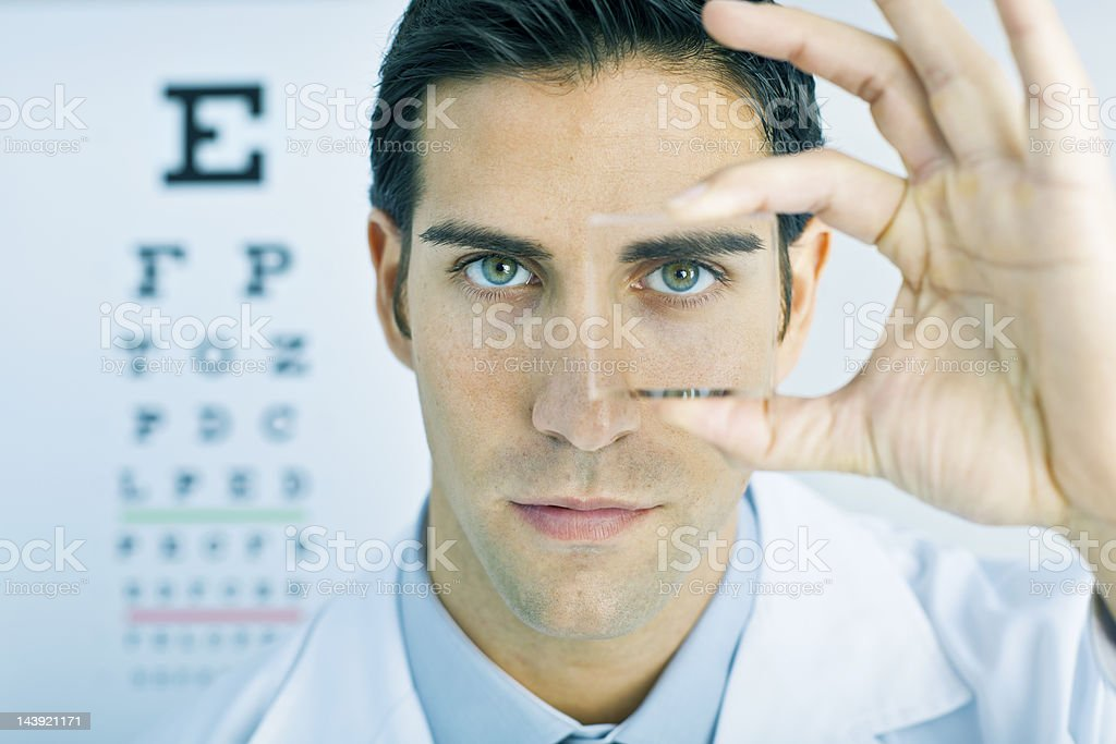 Vision: optometrist looking through a lens royalty-free stock photo