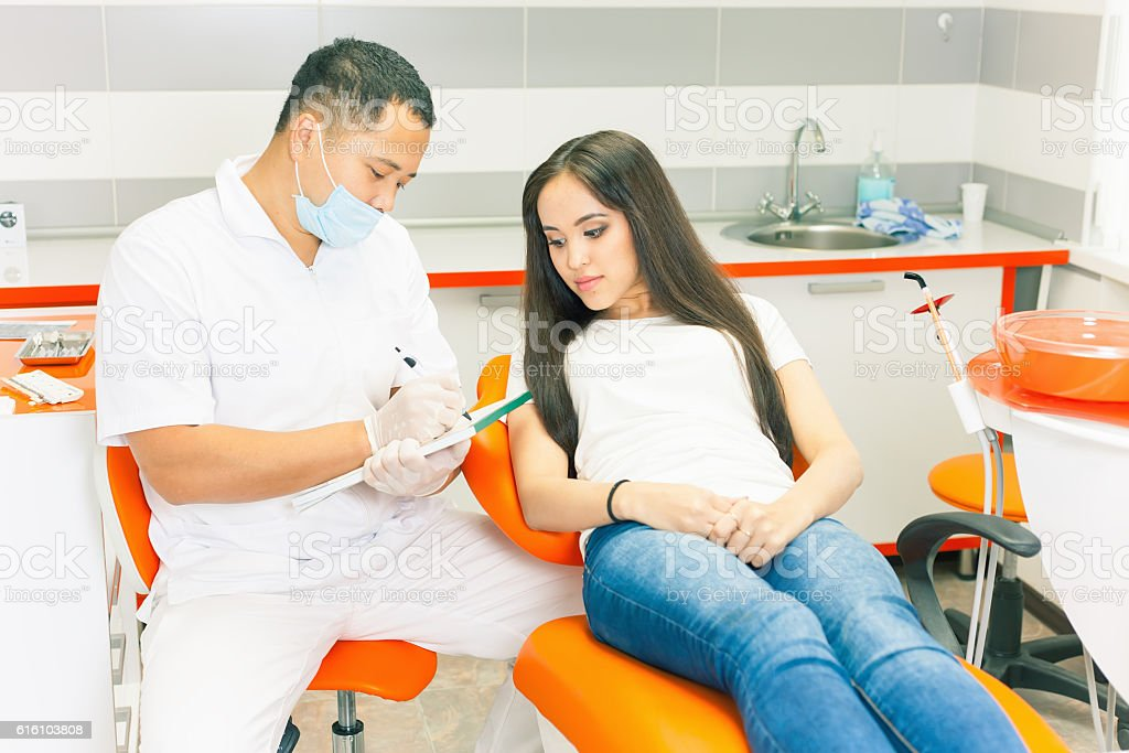 Visit patient to dentist doctor. Beautiful asian woman smile with...