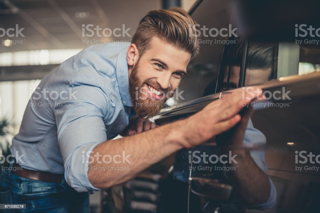 Visiting car dealership stock photo