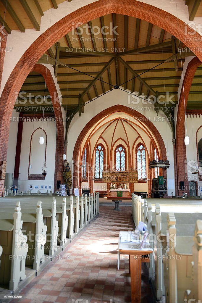 visiting the church of Warnemuende on Baltic sea region stock photo