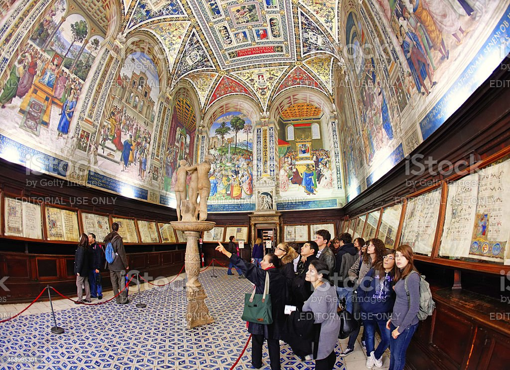 Visiting the Piccolomini library in Siena Cathedral stock photo