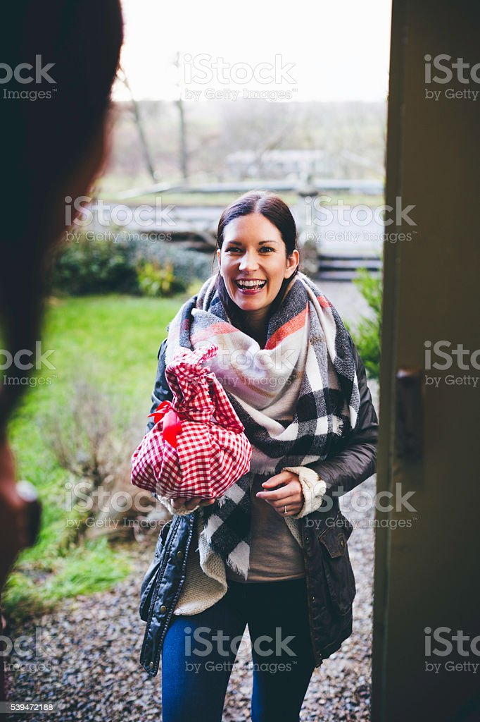 Visitor Arriving with a Gift stock photo