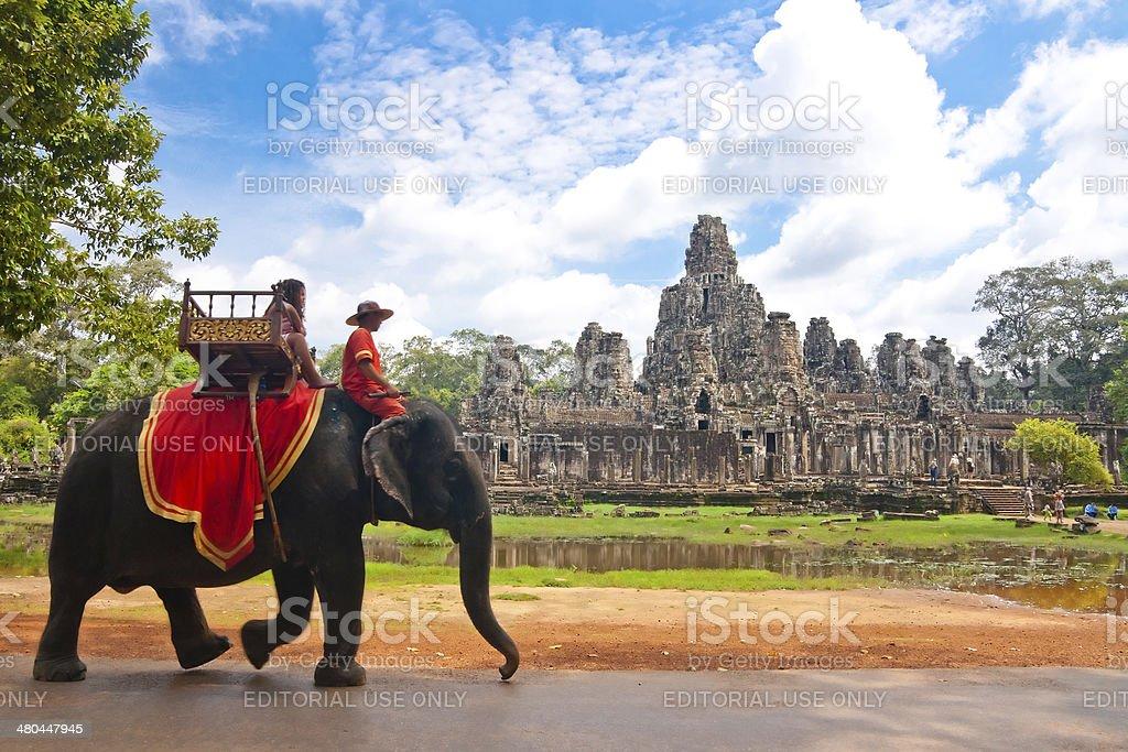 Visitor at the bayon in Angkor stock photo