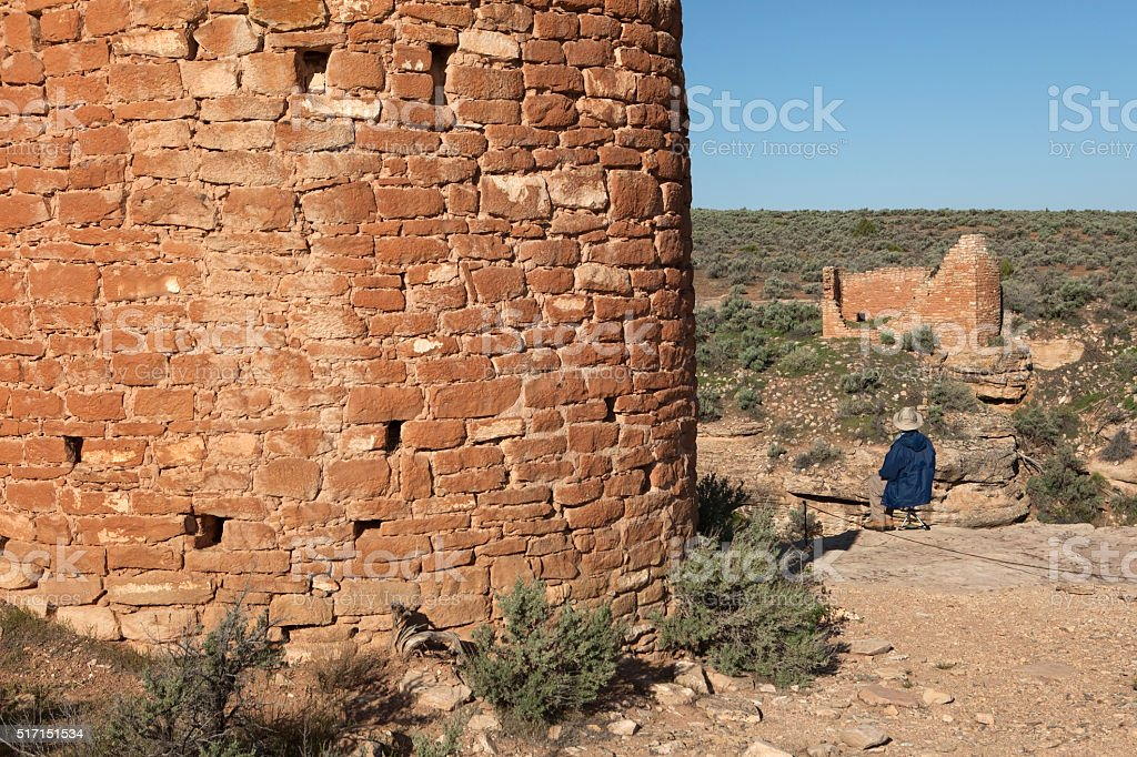 Visitor enjoys ancient Pueblo ruins Hovenweep National Monument stock photo