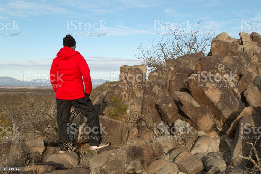 Visitor explores Three Rivers Petroglyphs Alamogordo New Mexico stock photo