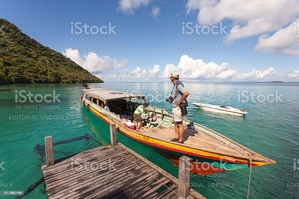 Visitor landed at the tourist jetty in Bohey Dulang island. stock photo