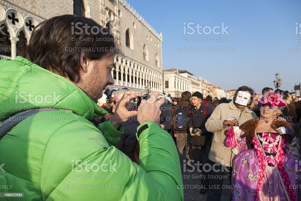 Visitor takes Pictures at Venice Carnival royalty-free stock photo