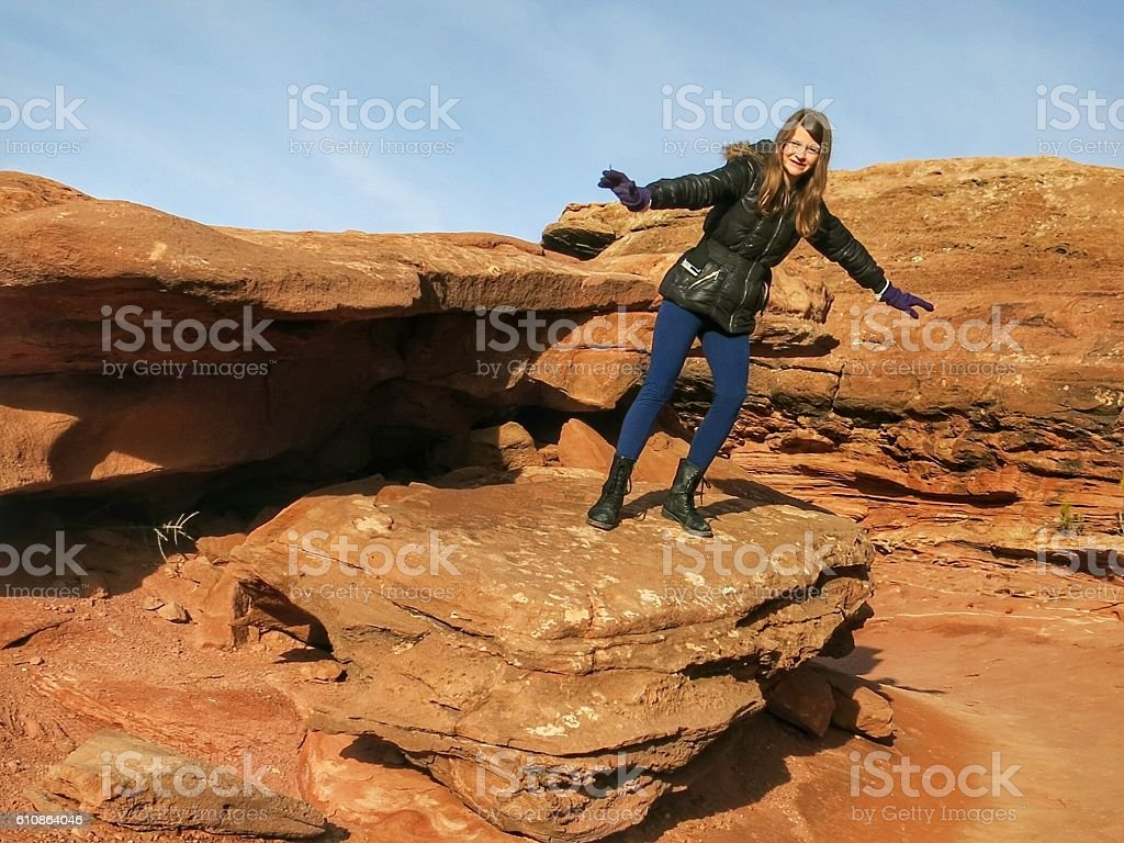 Visitor Tourist Girl, Red Rock Erosion Boulders, Stairs, Canyonlands, Utah stock photo